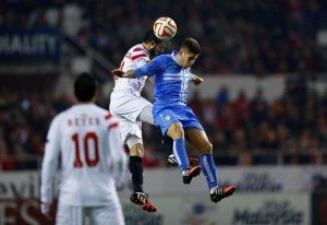 Sevilla's Nicolas Martin Pareja and Rijeka's Andrej Kramaric jump for the ball during their soccer match in Seville