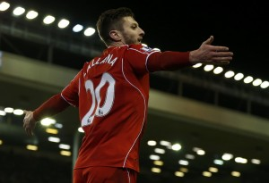 Liverpool's Lallana celebrates his second goal against Swansea City during their English Premier League soccer match in Liverpool