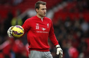Dropped Liverpool goalkeeper Simon Mignolet warms up before their English Premier League soccer match against Manchester United at Old Trafford in Manchester
